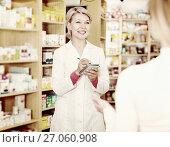 Купить «Seller helping customer to choose care products», фото № 27060908, снято 15 марта 2017 г. (c) Яков Филимонов / Фотобанк Лори