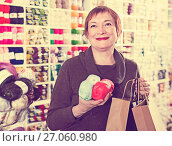 Купить «Woman holding shopping bags and accessories for knitting and embroidery», фото № 27060980, снято 10 мая 2017 г. (c) Яков Филимонов / Фотобанк Лори