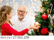 Купить «grandfather and granddaughter at christmas tree», фото № 27062208, снято 14 сентября 2014 г. (c) Syda Productions / Фотобанк Лори