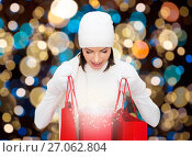Купить «woman in winter hat with christmas shopping bags», фото № 27062804, снято 15 августа 2013 г. (c) Syda Productions / Фотобанк Лори