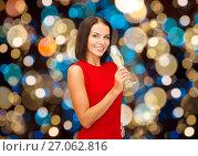 Купить «smiling woman holding glass of sparkling wine», фото № 27062816, снято 15 августа 2013 г. (c) Syda Productions / Фотобанк Лори