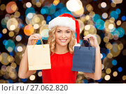 Купить «woman in santa hat with christmas shopping bags», фото № 27062820, снято 27 сентября 2013 г. (c) Syda Productions / Фотобанк Лори