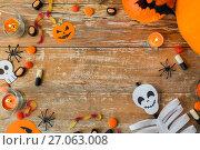 Купить «halloween decorations with space on wooden boards», фото № 27063008, снято 18 сентября 2017 г. (c) Syda Productions / Фотобанк Лори