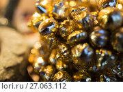 Купить «close up of golden christmas decoration», фото № 27063112, снято 1 декабря 2016 г. (c) Syda Productions / Фотобанк Лори