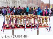 Купить «Кубки и медали на столике, лыжные соревнования», фото № 27067484, снято 11 февраля 2017 г. (c) Кекяляйнен Андрей / Фотобанк Лори