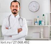 Купить «Male doctor having a productive day helping», фото № 27068492, снято 9 апреля 2020 г. (c) Яков Филимонов / Фотобанк Лори