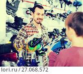 Купить «Master fixing roller-skates for boy customer in sports store», фото № 27068572, снято 21 декабря 2016 г. (c) Яков Филимонов / Фотобанк Лори