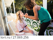 Купить «Beautician applying lip gloss to bride in balcony», фото № 27069256, снято 2 мая 2017 г. (c) Wavebreak Media / Фотобанк Лори