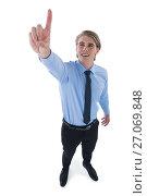 Купить «High angle view of smiling businessman touching invisible screen», фото № 27069848, снято 6 июня 2017 г. (c) Wavebreak Media / Фотобанк Лори