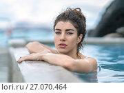 Купить «Girl relaxing in geothermal pool outdoors», фото № 27070464, снято 23 марта 2017 г. (c) Andriy Bezuglov / Фотобанк Лори