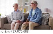 Купить «senior couple having argument at home», видеоролик № 27070688, снято 20 сентября 2017 г. (c) Syda Productions / Фотобанк Лори