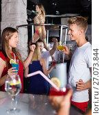 Купить «Female and male clubbing with cocktail in the club on party», фото № 27073844, снято 28 августа 2017 г. (c) Яков Филимонов / Фотобанк Лори