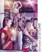 Купить «Female and male clubbing with cocktail in the club on party», фото № 27073848, снято 28 августа 2017 г. (c) Яков Филимонов / Фотобанк Лори