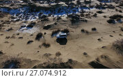 Купить «Aerial view of suv moving through the snow-covered desert in winter. Western Kazakhstan, Mangyshlak Peninsula.», видеоролик № 27074912, снято 9 мая 2017 г. (c) Вячеслав Позднышев / Фотобанк Лори