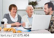 Купить «Aged couple signing agreement», фото № 27075404, снято 4 июля 2020 г. (c) Яков Филимонов / Фотобанк Лори