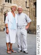 Купить «loving mature spouses enjoying walk», фото № 27075724, снято 20 сентября 2018 г. (c) Яков Филимонов / Фотобанк Лори