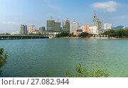 Купить «Embankment of the Sanya River in Sanya City on Hainan Island», фото № 27082944, снято 2 апреля 2017 г. (c) Юлия Машкова / Фотобанк Лори