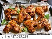 Купить «Baked chicken wings», фото № 27083228, снято 26 сентября 2017 г. (c) Татьяна Волгутова / Фотобанк Лори