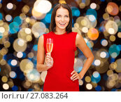 smiling woman holding glass of sparkling wine. Стоковое фото, фотограф Syda Productions / Фотобанк Лори