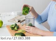 Купить «woman hand adding pea to measuring cup», фото № 27083388, снято 21 февраля 2017 г. (c) Syda Productions / Фотобанк Лори