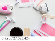 Купить «hair removal wax, epilator and safety razor», фото № 27083424, снято 12 апреля 2017 г. (c) Syda Productions / Фотобанк Лори