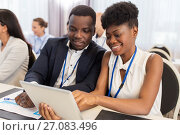 Купить «team with tablet pc at business conference», фото № 27083496, снято 27 августа 2017 г. (c) Syda Productions / Фотобанк Лори