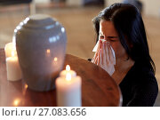 Купить «woman with cremation urn at funeral in church», фото № 27083656, снято 20 марта 2017 г. (c) Syda Productions / Фотобанк Лори
