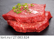 Купить «two marbled beef steaks on slate tray», фото № 27083824, снято 1 октября 2017 г. (c) Oksana Zh / Фотобанк Лори