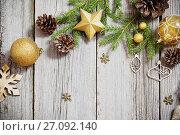 Купить «Golden decoration on old wooden background», фото № 27092140, снято 29 октября 2016 г. (c) Майя Крученкова / Фотобанк Лори
