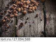 Купить «Mixed nuts on old wooden background», фото № 27094588, снято 21 ноября 2016 г. (c) Майя Крученкова / Фотобанк Лори