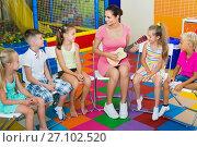 Купить «Children sitting with teacher and listening to music in class», фото № 27102520, снято 19 января 2019 г. (c) Яков Филимонов / Фотобанк Лори