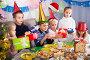 children presenting gifts during Christmas dinner, фото № 27102608, снято 18 октября 2017 г. (c) Яков Филимонов / Фотобанк Лори