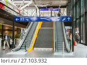 Geneva, Switzerland - JUL 02, 2017: Escalators in building of Geneve-Aeroport railway station. Редакционное фото, фотограф Юлия Кузнецова / Фотобанк Лори