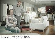 Купить «Couple is choosing new furniture», фото № 27106856, снято 16 мая 2017 г. (c) Яков Филимонов / Фотобанк Лори