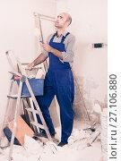 Купить «Constructor is standing with roller in uniform», фото № 27106880, снято 18 мая 2017 г. (c) Яков Филимонов / Фотобанк Лори