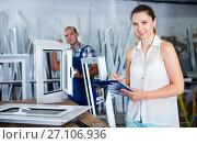 Купить «Woman manager standing with clipboard in workshop», фото № 27106936, снято 19 июля 2017 г. (c) Яков Филимонов / Фотобанк Лори