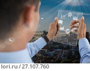 Купить «man holding glass interface», фото № 27107760, снято 23 февраля 2020 г. (c) Wavebreak Media / Фотобанк Лори