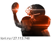 American football player in jersey and helmet holding ball. Стоковое фото, агентство Wavebreak Media / Фотобанк Лори