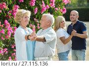 Купить «Two generation dancing in park», фото № 27115136, снято 24 августа 2017 г. (c) Яков Филимонов / Фотобанк Лори