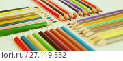 Купить «colored pencils lying in rows», фото № 27119532, снято 11 января 2017 г. (c) Татьяна Яцевич / Фотобанк Лори