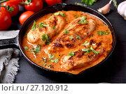 Купить «Chicken breast with tomato sauce in frying pan», фото № 27120912, снято 20 сентября 2017 г. (c) Татьяна Волгутова / Фотобанк Лори