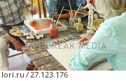 Купить «Artists working together at table 4k», видеоролик № 27123176, снято 5 апреля 2020 г. (c) Wavebreak Media / Фотобанк Лори