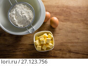 Купить «Flour in strainer with eggs and cheese», фото № 27123756, снято 5 мая 2017 г. (c) Wavebreak Media / Фотобанк Лори