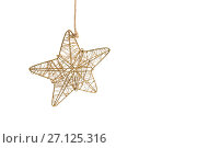 Купить «Handmade star hanging against white background», фото № 27125316, снято 8 июня 2017 г. (c) Wavebreak Media / Фотобанк Лори