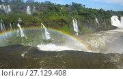 Купить «Cataratas del Iguazu Waterfall on Iguazu River in National Park, Parana, Brazil», видеоролик № 27129408, снято 22 марта 2017 г. (c) Яков Филимонов / Фотобанк Лори