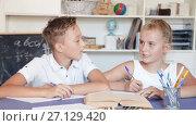 Brother with sister are doing homework at home. Стоковое видео, видеограф Яков Филимонов / Фотобанк Лори