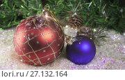 Купить «New Year's ball against the background of Christmas tree,Christmas still life», видеоролик № 27132164, снято 23 августа 2009 г. (c) Куликов Константин / Фотобанк Лори