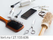 Купить «smartphone, scissors, brushes and other hair tools», фото № 27133636, снято 12 апреля 2017 г. (c) Syda Productions / Фотобанк Лори