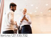 Купить «couple with smartphone at business conference», фото № 27133732, снято 27 августа 2017 г. (c) Syda Productions / Фотобанк Лори