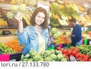 Купить «Woman choosing fruit», фото № 27133780, снято 18 марта 2017 г. (c) Яков Филимонов / Фотобанк Лори